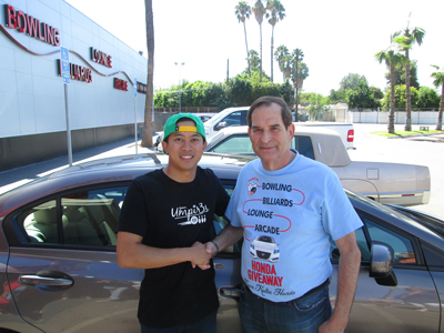 Mark Alvarino receiving a car